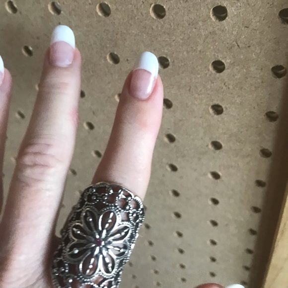 Silver scroll ring w/tiny hot pink rhinestone.